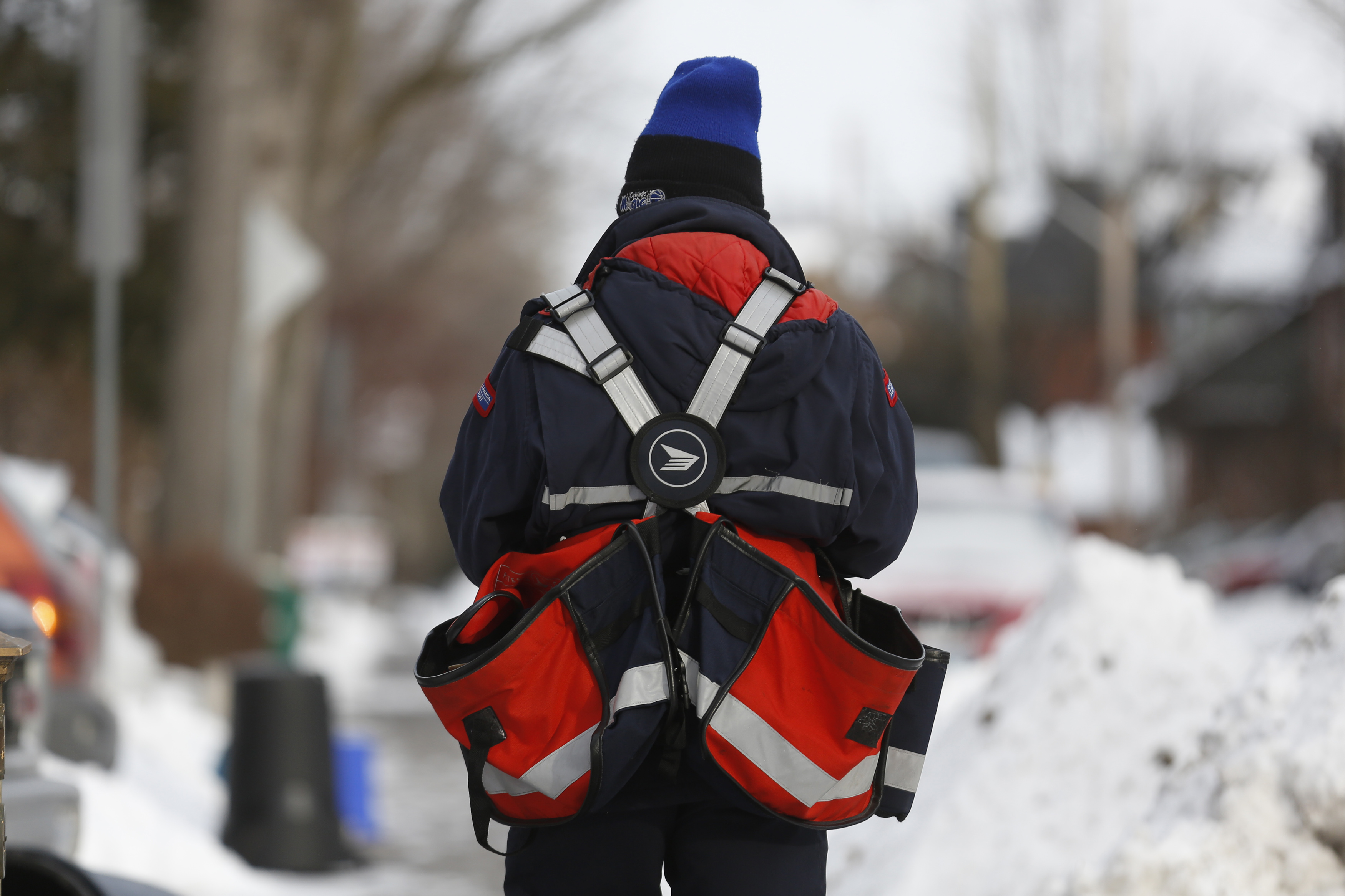 a canada post employee delivers mail in ottawa december 11 2013